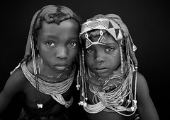 Mwila Young Girls, Angola (Eric Lafforgue) Tags: africa girls two portrait people blackandwhite tourism girl childhood horizontal dreadlocks female youth standing person beads kid child tribal innocence tribe twopeople humanbeing plaits huila angola headandshoulders tourismo southernafrica mwela lookingatcamera twopersons cauri ethnicgroup traditionalhairstyle  mumuila   mumuhuila mwila      southangola mumuhuilatribe mwilatribe nontombi ango01850 caurishells
