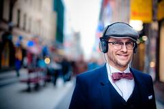 Stranger (TGKW) Tags: street boy portrait people man hat fashion shirt glasses sweden stockholm bokeh tie bow headphones spectacles blazer neckwear 4463