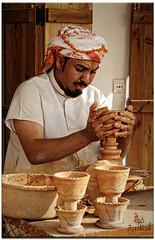 Pottery Maker  صانع الفخار (Fawaz Abdullah) Tags: old portrait clay pottery maker handcrafts صانع حرف قديم deflect يدوية حرفه طين مبخر الجنادرية الفخار حرفة المبخره laser707 fawazabdullah فوازعبدالله aljanadiriyah
