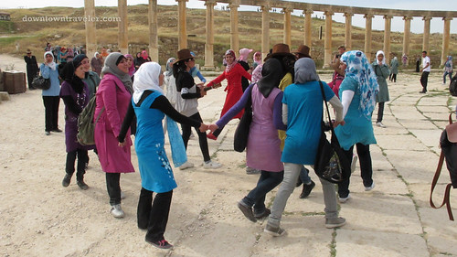 Schoolgirls dancing and singing in Jerash Jordan
