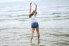 Soak up the sun (Danielle Pearce) Tags: ocean blue texture film beach water girl fun happy bay dance nikon pretty tan overlay shorts beachy d5000