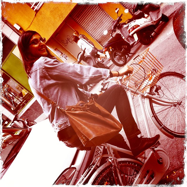 Pauline rides my bike
