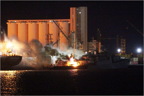 NATO warplanes bomb Libyan ships at the Tripoli port. The imperialist forces have escalated their bombing operations after two months of war against this oil-rich North African state. by Pan-African News Wire File Photos