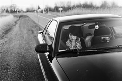 (onlyfools.) Tags: road film car 35mm glare country tracks babe stare staring olympusstylus glarring