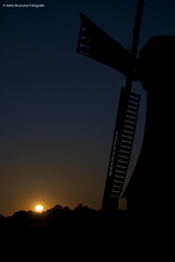 Typical Dutch (Adrie Bruinsma) Tags: sunset sun netherlands windmill dutch night dark thenetherlands silhouet scheemda