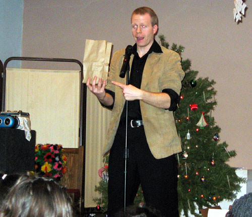 Magician Eddy Ray Performing at a Christmas Event by eddyraymagic1