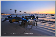 bali - back from fishing (fiftymm99) Tags: sunset sea people bali water boat seaside fishing fisherman sand nikon wave jimbaran d300 fiftymm fiftymm99 gettyimagessingaporeq2