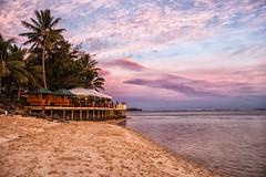 The Rarotongan (Martin Jonathan NZ) Tags: raro rarotonga rarotongan sunset beach water lagoon clouds holiday canon 500d
