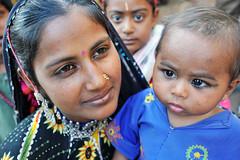 Madaris (Leonid Plotkin) Tags: woman baby india girl asia child traditional mother tribal tradition tribe ethnic gujarat gurukul madari madhari wadipra