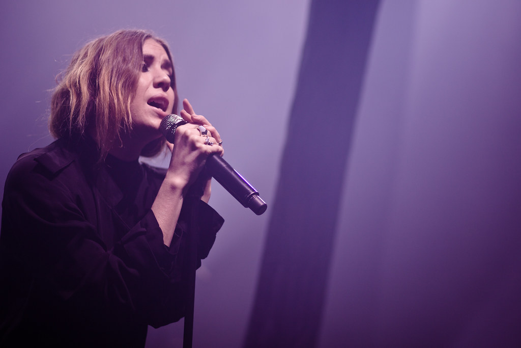 Lykke Li holding a mic and such