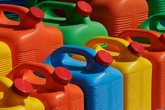 "Colorful water jug assortment (IronRodArt - Royce Bair (""Star Shooter"")) Tags: red orange color green water yellow colorful different bright display storage plastic size same jug choice liquid assortment assorted containers"