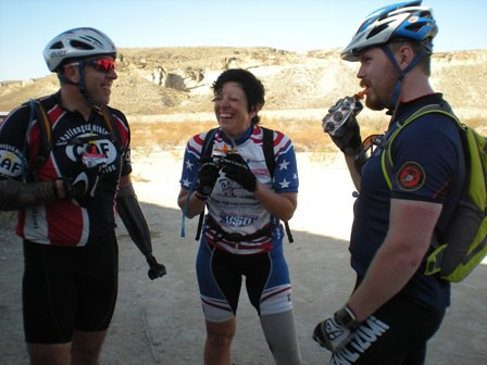 Three warriors take a quick water break on day 2