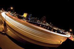 Pulse (Rudy Malmquist) Tags: city light dutch night canon evening highway stream long exposure cityscape shot streak shots michigan grand s rapids fisheye expressway curve tilt 15mm 60 stacked ƒ28 us131