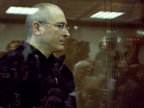 Russian ex-oil tycoon Mikhail Khodorkovsky (L) and his co-defendant Platon Lebedev (R) stand behind a glass wall at a courtroom in Moscow, on May 17, 2011. A Russian court adjourned until May 24 the appeal of Khodorkovsky against his conviction in a fraud by hegtor