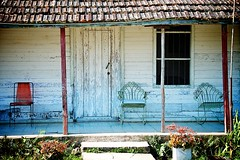 Cuban Farmhouse (lynn.h.armstrong) Tags: poverty door camera old flowers roof red vacation plants brown sun sunlight white ontario canada green art texture window grass metal farmhouse lens geotagged photography photo interesting mac chair aperture nikon long peeling paint flickr jeep chairs zoom farmers farm south shingles cuba poor cement steps may safari lynn h walls rocking nikkor posts varadero cuban armstrong stormont vr afs gettyimages dx sault ingleside 2011 ifed 18200mm f3556 attributionnoderivs vrii d7000 lynnharmstrong requesttolicence