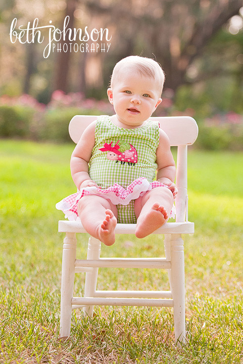 nine month old baby girl in white chair in tallahassee