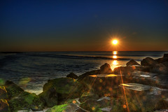 Guiding Light (Moniza*) Tags: ocean sunset sea sky sun seascape beach nature water silhouette clouds sunrise landscape dawn newjersey twilight sand nikon rocks waves bokeh nj rocky explore shore jersey bluehour jerseyshore oceangrove d90 explored moniza