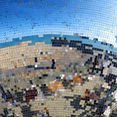 Disco on the Beach (CardiganKate) Tags: blue sea sky reflection beach water brighton mirrors pebbles doughnut seafront mirrorball discoball 50200mm cracked pixelate ohsosocial pentaxkr wwwkatebenjamincom
