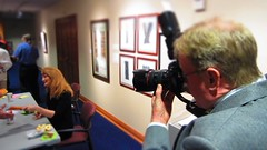 Doug Knutson snaps Krista signing