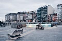 A Corua (claudiagomlop) Tags: surfers corua city galicia vsco vscocam ciudad fuente winter water