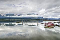 calm (Keith.CA) Tags: cloudy clouds lake shuswaplake salmonarm houseboat marina shuswap britishcolumbia nautical dock reflection mountains