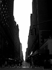 Looking Down The Valley (raisinsawdust - (aka: tennphoto)) Tags: street nyc newyorkcity light sky people bw newyork buildings vanishingpoint nikon manhattan pedestrians crosswalk 2011 d90 concretecanyon blackwhitephotos nikond90