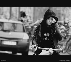 The Unknown Stranger (Dobi.) Tags: street girl beautiful amsterdam bike europe stranger 300mm cycle rider dobi 2011 d90