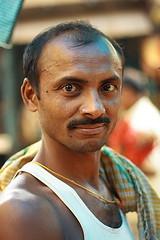 porter at the flower market | Kolkata (arnabchat) Tags: flowers light portrait people india man flower guy face dark eyes exposure market porter kolkata bengal seller calcutta bangla westbengal 50f18 duallight arnabchat mullickghat arnabchatterjee mullickghatflowermarket