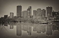 262/365 - April 11, 2011 - Time for Reflection (Keeperofthezoo) Tags: canada reflection calgary water skyline buildings pond cityscape ab alberta dowtown princesislandpark downtowncalgary project365 canonxsi silverefexpro2