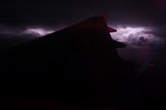 lightning storm, 5000ft. in the air (jrfiorello) Tags: sky clouds airplane inflight thunderstorm lightning