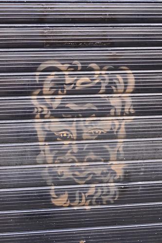 Gold Gargoyle on Black Rippled Door