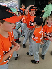 Top of the First (spinadelic) Tags: orange black bird sports boys hat rock kids fence bench children spring pants baseball little top gray first chainlink april around arkansas uniforms dugout embroidered orioles inning milling tball stevespencer teeball 2011