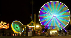 Carnival of Colors (Robby Ryke) Tags: longexposure carnival flower night fun lights spring gravity ferriswheel zero carnivalofcolors