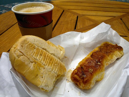Clockwise from right: quesito, tostada, and café con leche