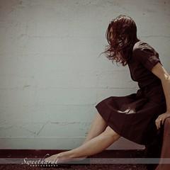 07 :: 31 (sweethardt) Tags: woman white selfportrait black brick wall shirt sitting dress windy brunette