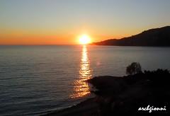 al tramonto (archgionni) Tags: sunset sea sky orange sun water tramonto mare waves cielo sole acqua reflexions arancione onde