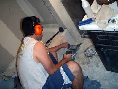Kenny removing tile