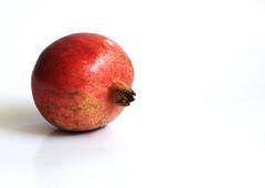 First Harvest of Fall - Pomegranate (rarefruitfan) Tags: pomegranate fall harvest fruit isolated rosh hashanah biblical garden