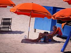 If You Like to Linger Where It's Shady... (Don Henderson) Tags: beachumbrellarental ocmd oceancity maryland atlnaticocean ukulelelady beachumbrella complementarycolors beach shade