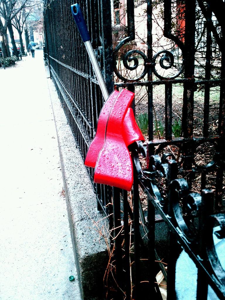 Discarded red shoes on Milton