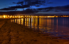 Bay by Night (Richard Beech (rdb75)) Tags: longexposure sea night reflections lights worldheritagesite esplanade dorset weymouth reflectedlight jurassiccoast 2011 weymouthbeach weymouthbay richardbeech rdb75