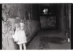 """Abandoned Bricks"" (RE) Tags: life old city nyc shadow summer urban blackandwhite film girl mystery youth analog dark minolta legs tunnel teen grainy gi adolescents 35mml kodakt400"