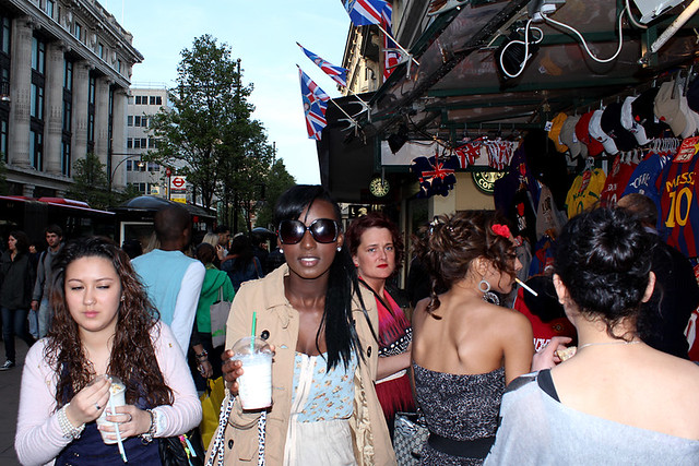 Glamourous girls at souvenir stall on Oxford Street