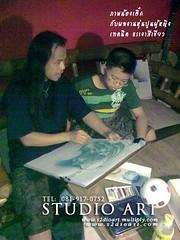 ครูสอนศิลปะ กำลังสอนวาดเส้น