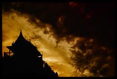 Skies on Fire (TeohEH) Tags: road city travel light sunset sky sun clouds canon dark landscape thailand temple 50mm prime san shrine warm skies bangkok khao khaosan backpackers teoh 550d t2i