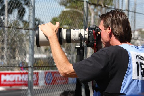 MLB Legend Randy Johnson shooting some photos of the on-track action