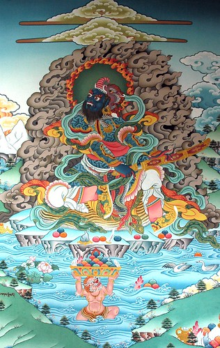 Guardian King, Blue Dharma Lord sitting on a tiger skin on his own island, Naga lifting gold lotus bowl of wish fulfilling jewels, wall mural, Gelugpa Monastery, Pharping, Nepal by Wonderlane