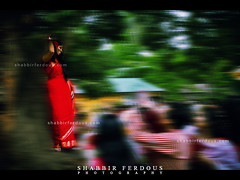 Girl in Red Saree : pohela boishakh 1418 Dhaka Bangladesh (Shabbir Ferdous) Tags: light red people woman color colour girl women colorful photographer shot celebration saree sari bangladesh bangla 1418 bengali bangladeshi pohelaboishakh april14 ramna nababarsho noboborsho shuvonoboborsho ef1635mmf28liiusm poilaboishakh shubhonoboborsho bangladeshigirl charukola shabbirferdous banglacalendar boishakhiparade banglagirls bdgirls celebrationinbangladesh canoneos1dmarkiv batamul botmul chayanot wwwshabbirferdouscom shabbirferdouscom