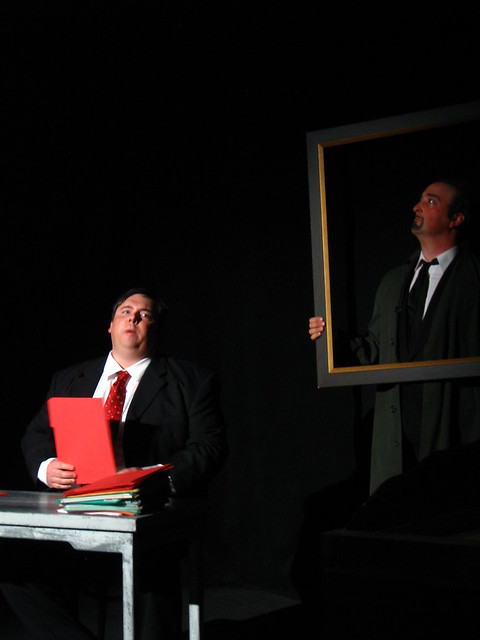 Stanislov (Scott Leggett) and his portrait of Lenin (Jonas Oppenhaim).