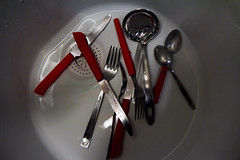116/365 (Tom Wachtel) Tags: red white reflection water kitchen grey shiny shine sink steel gray knife fork spoon bowl drop basin wash meal droplet gleam knives 365 utensil washing porcelain cutlery stainless flatware